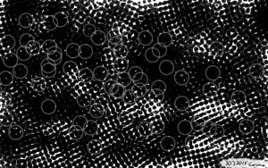 Mustista ja valkoisista pisteistä ja palluroista koostuva taideteos.